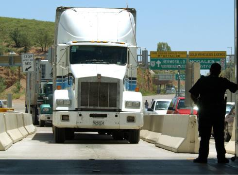 A United States Customs agent waits for a northbound truck crossing the border to enter the United States from Nogales, Mexico.